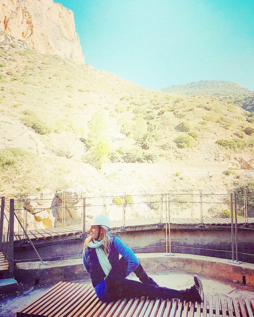 Yoga Pose Nette Nirmala in Marichyasana on the Caminito del Rey